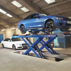Blue BMW on scissor lift